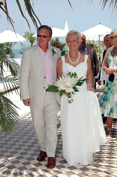 Mary and Alan walking down the aisle at Coco Ocean
