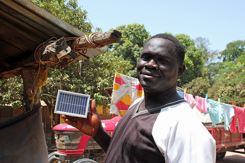 The village head of Kanuma holding a solar panel