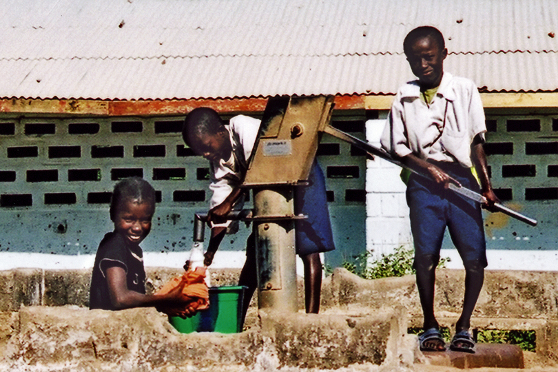 Children colecting water in The Gambia